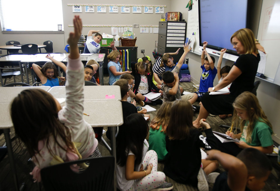 Photo - File: Students raise their hands during a reading exercise in Elementary school Teacher Natalie Shanks' class at Timber Ridge Elementary School in Broken Arrow. JESSIE WARDARSKI/ Tulsa World file