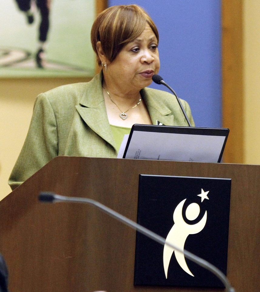 Photo - Patricia Watson Hunt speaks to the Oklahoma City School Board on May 28, 2013 about test scores at Marcus Garvey Leadership Academy. The school board is considering ending relations with the academy for the next academic year. Photo by KT King, The Oklahoman