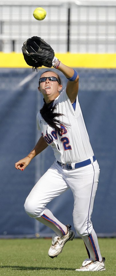 Photo - COLLEGE SOFTBALL: University of Florida's Kelsey Bruder makes a catch for an out in the sixth inning during a softball game between UCLA and Florida in the first session of the Women's College World Series at ASA Hall of Fame Stadium in Oklahoma City, Thursday, June 3, 2010.  UCLA won, 16-3, in six innings. Photo by Nate Billings, The Oklahoman ORG XMIT: KOD