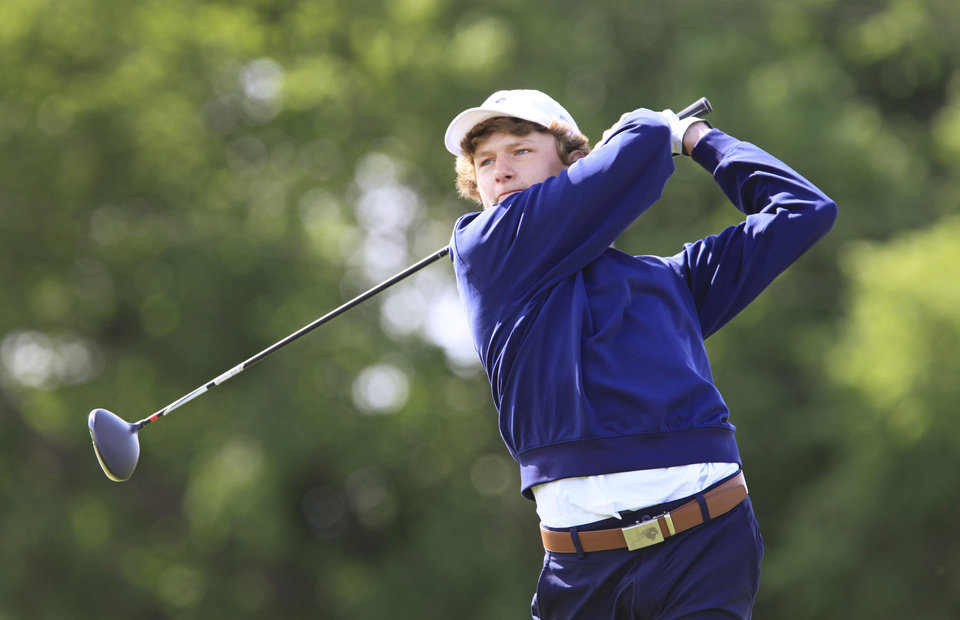Photo - Sam Jackson, Heritage Hall, tees off during the Class 4A boys golf at Lake Hefner Golf Course, Tuesday May 13, 2014.  Photo by David McDaniel, The Oklahoman