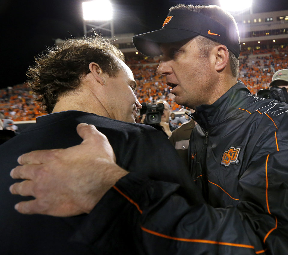 Photo - Oklahoma State coach Mike Gundy and West Virginia coach Dana Holgorsen meet after a college football game between Oklahoma State University (OSU) and West Virginia University at Boone Pickens Stadium in Stillwater, Okla., Saturday, Nov. 10, 2012. Oklahoma State won 55-34. Photo by Bryan Terry, The Oklahoman