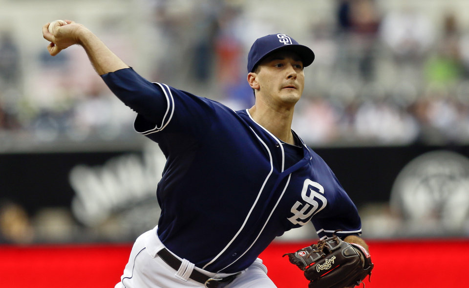 San Diego Padres starting pitcher Burch Smith works against the Los Angeles Dodgers in the first inning of a baseball game Saturday, Sept. 21, 2013, in San Diego. (AP Photo/Lenny Ignelzi)