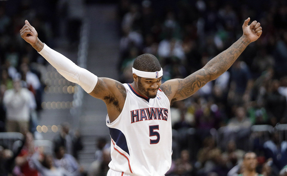 Photo - Atlanta Hawks forward Josh Smith reacts after a Hawks basket in the second half of an NBA basketball game against the Boston Celtics on Friday, Jan. 25, 2013, in Atlanta. Atlanta won 123-111 in double-overtime. (AP Photo/John Bazemore)
