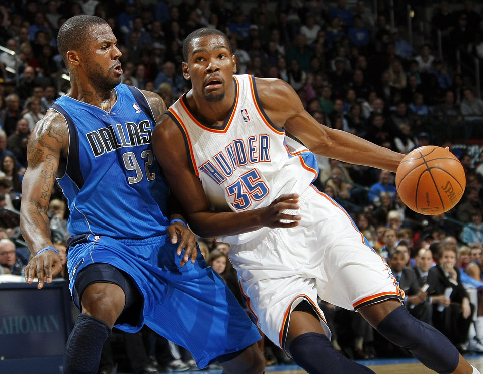Photo - Oklahoma City's Kevin Durant (35) drives the ball as DeShawn Stevenson (92) of Dallas defends during the NBA basketball game between the Dallas Mavericks and the Oklahoma City Thunder at the Oklahoma City Arena in Oklahoma City, Monday, Dec. 27, 2010. Dallas won, 103-93. Photo by Nate Billings, The Oklahoman