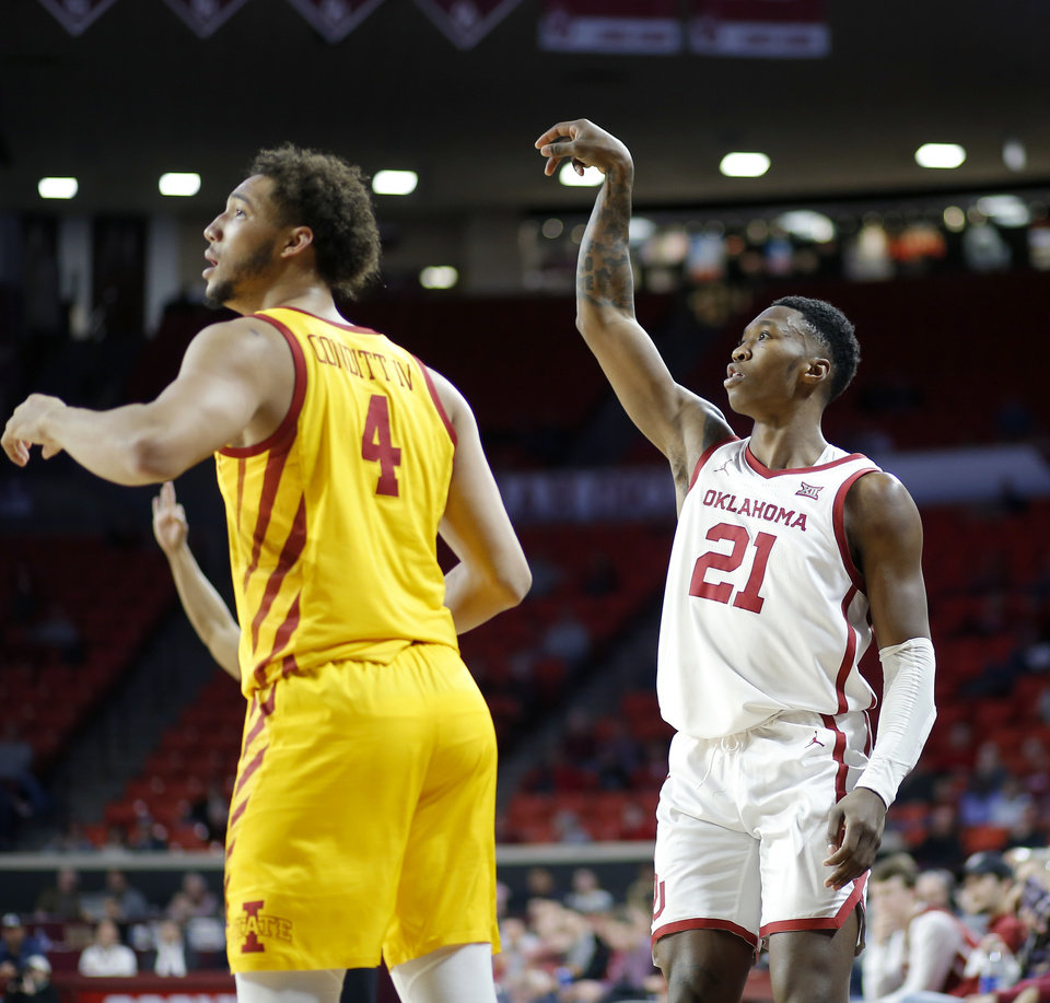 Photo - Oklahoma's Kristian Doolittle (21) watches his shot go in the basket next to Iowa State's George Conditt IV (4) during an NCAA basketball game between the University of Oklahoma Sooners (OU) and the Iowa State Cyclones at the Lloyd Noble Center in Norman, Okla., Wednesday, Feb. 12, 2020. [Bryan Terry/The Oklahoman]
