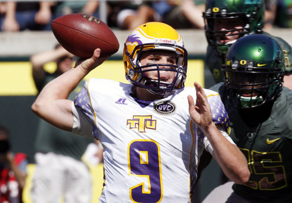 Photo -   Tennessee Tech quarterback Tre Lamb passes against pressure from Oregon defenders during the first half of their NCAA college football game in Eugene, Ore., Saturday, Sept. 15, 2012. (AP Photo/Don Ryan)