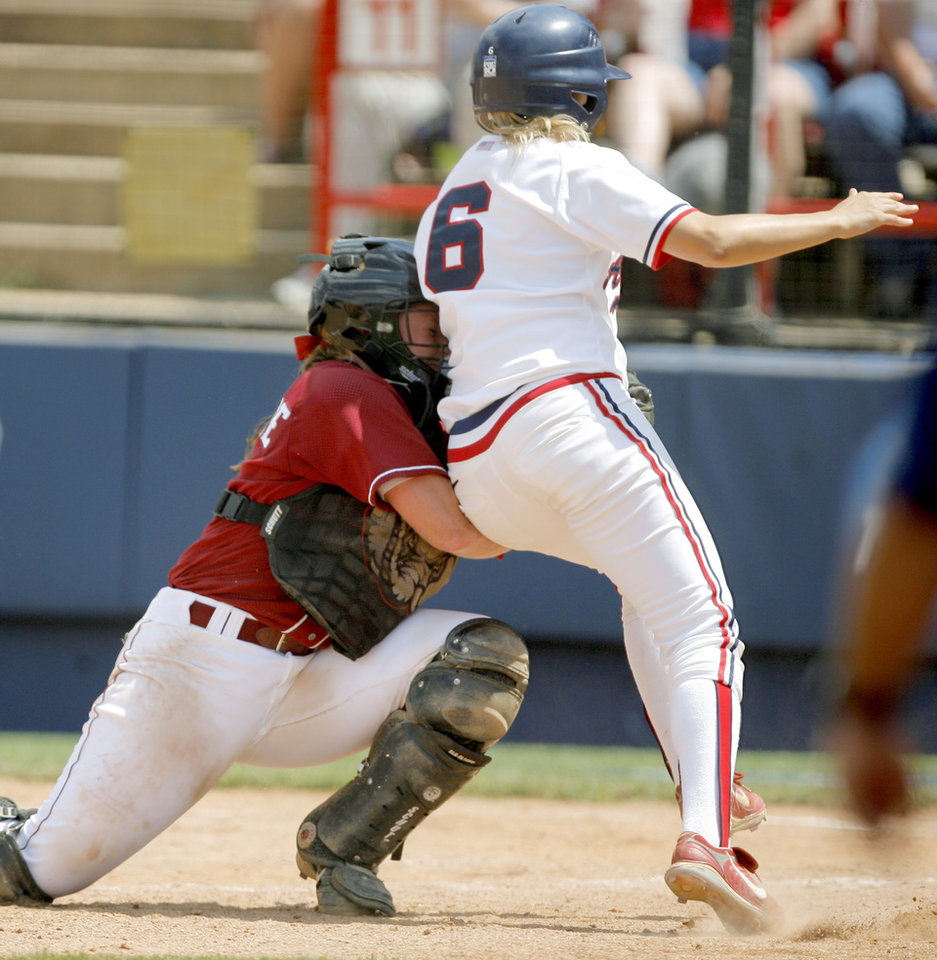 Ashley Holcomb of Alabama tags out Jil Malina of Arizona at home in the third inning during the Women\'s College World Series game between Alabama and Arizona at ASA Hall of Fame Stadium in Oklahoma City, Saturday, May 31, 2008. BY BRYAN TERRY, THE OKLAHOMAN
