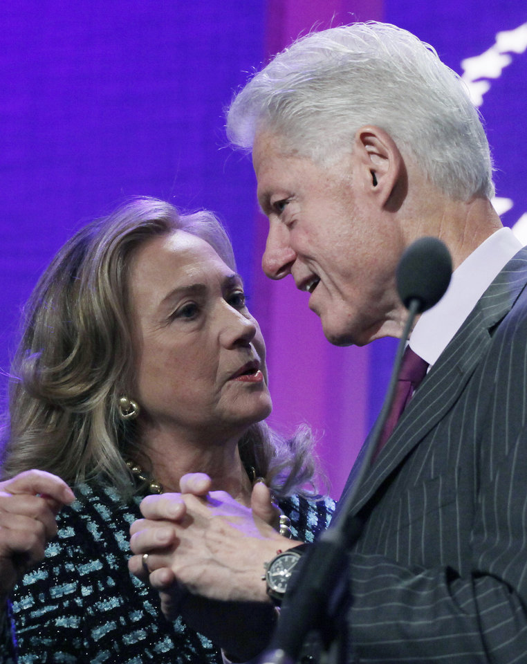 Photo -   United States Secretary of State Hillary Rodham Clinton is introduced by her husband, former U.S. President Bill Clinton, as she steps to the podium at the Clinton Global Initiative, Monday, Sept. 24, 2012 in New York. (AP Photo/Mark Lennihan)