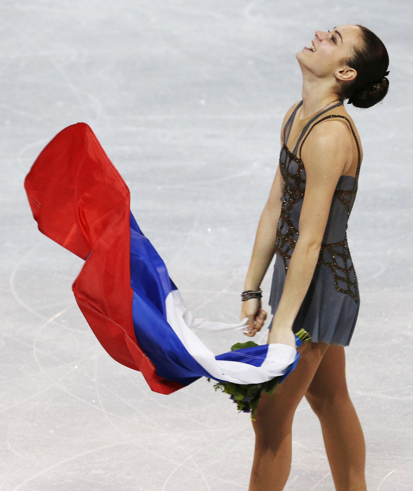 Photo - Adelina Sotnikova of Russia celebrates winning the women's free skate figure skating final at the Iceberg Skating Palace during the 2014 Winter Olympics, Thursday, Feb. 20, 2014, in Sochi, Russia. (AP Photo/Darron Cummings, File)