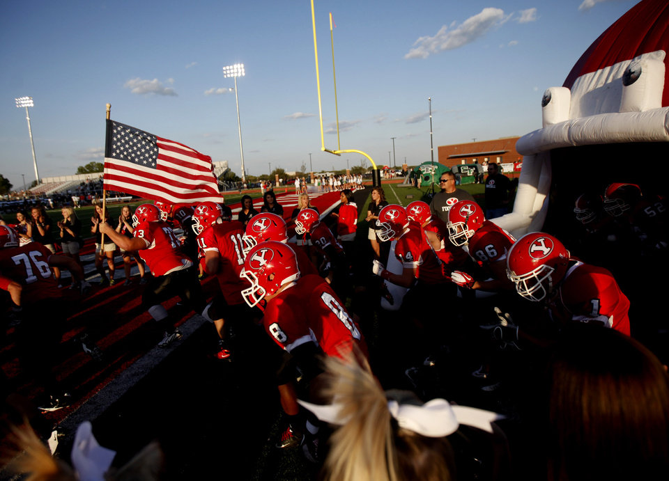 Photo - The Yukon football team takes the field before a high school football game against Edmond Santa Fe in Yukon, Okla., Friday, Sept. 9, 2011. Photo by Bryan Terry, The Oklahoman