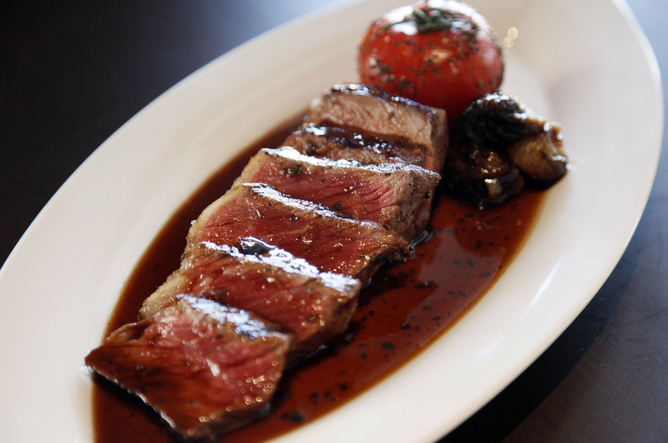 Photo - New York strip with roasted bone marrow demi, roasted tomato and balsamic glazed onions at Flint, the new restaurant inside the Colcord Hotel, in Oklahoma  City,.  NATE BILLINGS - THE OKLAHOMAN