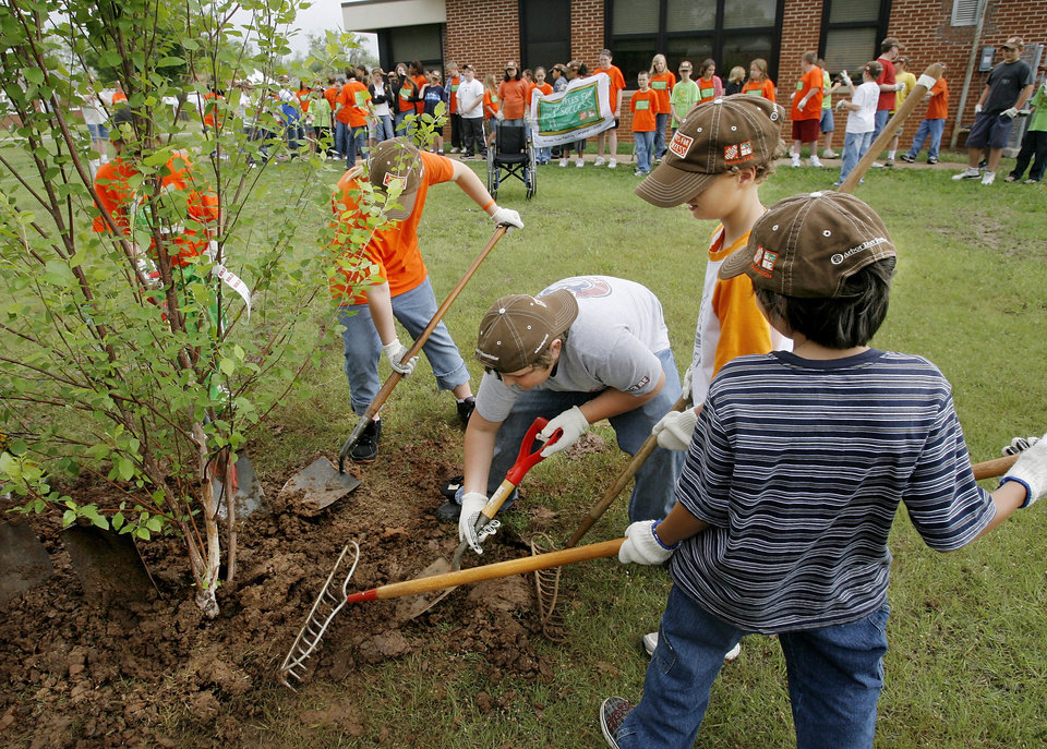 Photo - Students at East Side Elementary School planted trees around their school Friday morning, May 1, 2009.     Photo by JIM BECKEL, THE OKLAHOMAN
