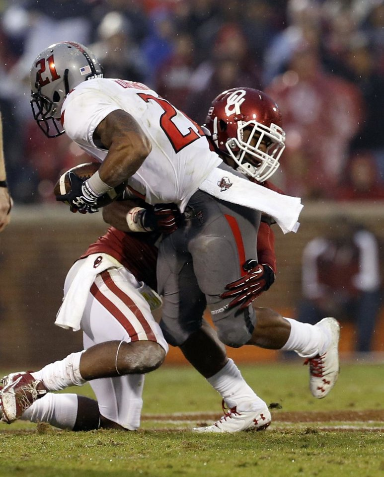 Oklahoma's Julian Wilson (2) brings down Texas Tech's DeAndre Washington (21) during a college football game where  the University of Oklahoma Sooners (OU) defeated the Texas Tech Red Raiders 38-30 at Gaylord Family-Oklahoma Memorial Stadium in Norman, Okla., on Saturday, Oct. 26, 2013. Photo by Steve Sisney, The Oklahoman