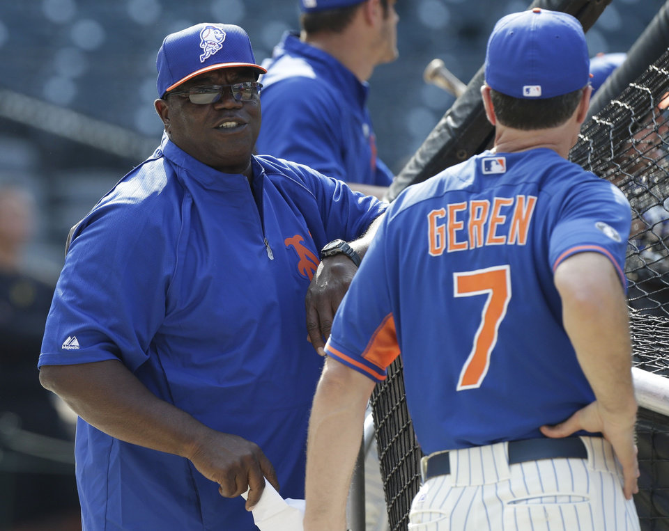 Photo - New York Mets batting coach Lamar Johnson speaks to Bob Geren, right, during batting practice before a baseball game against the Pittsburgh Pirates Tuesday, May 27, 2014, in New York.  (AP Photo/Frank Franklin II_