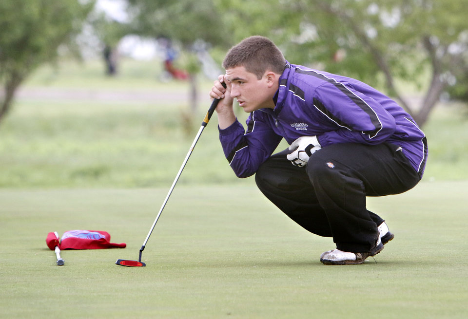 Photo - Anadarko's Austin Hunter lines up a putt during the class 4A boy's state golf tournament at the Lake Hefner Golf Course in Oklahoma City, OK, Monday, May 12, 2014,  Photo by Paul Hellstern, The Oklahoman