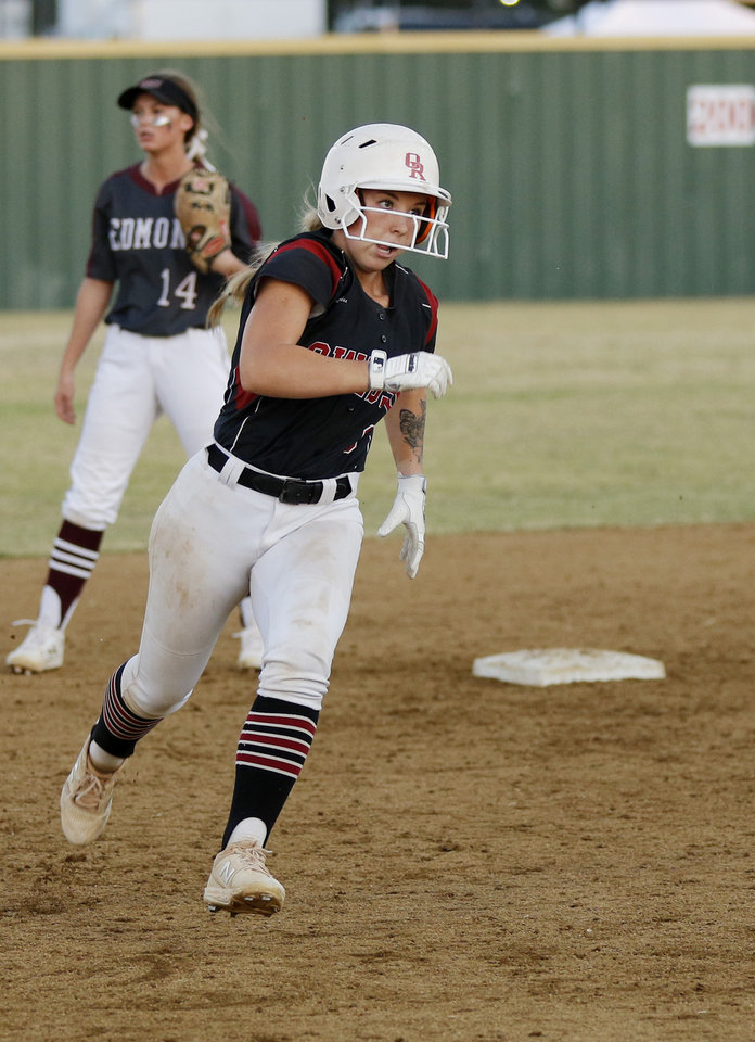 Photo - OHS #9 Payton Compton heads to third base during the 6A Fast Pitch Championship game between Edmond Memorial and Owasso at the Ball Fields at Firelake in Shawnee, Saturday, October 19, 2019. [Doug Hoke/The Oklahoman]