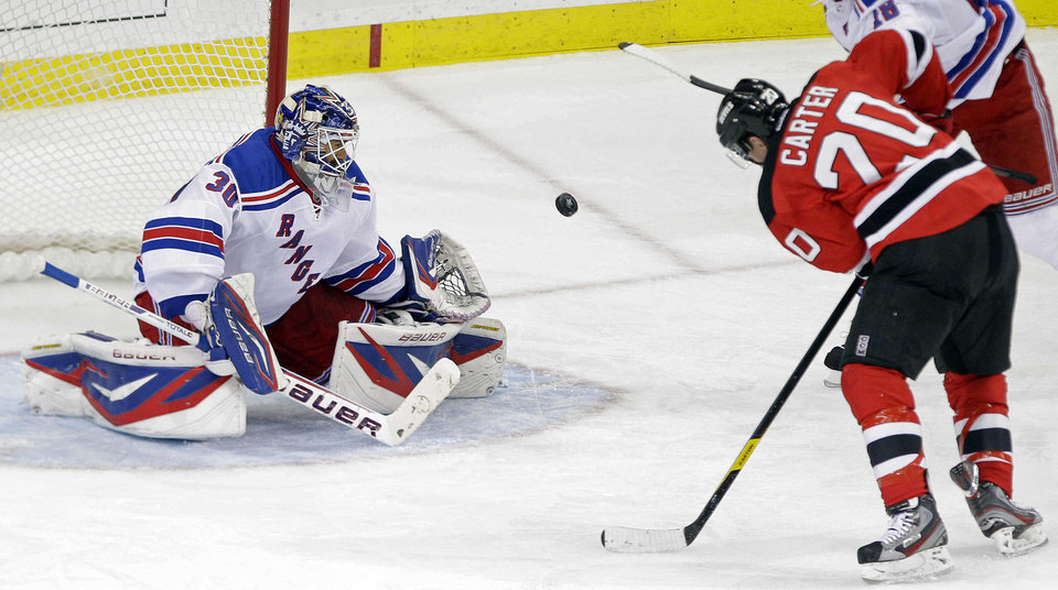 Photo -   New York Rangers goalie Henrik Lundqvist (30), of Sweden, stops a shot on the goal by New Jersey Devils' Ryan Carter (20) during the third period of game 3 of an NHL hockey Stanley Cup Eastern Conference final playoff series Saturday, May 19, 2012, in Newark, N.J. (AP Photo/Frank Franklin II)