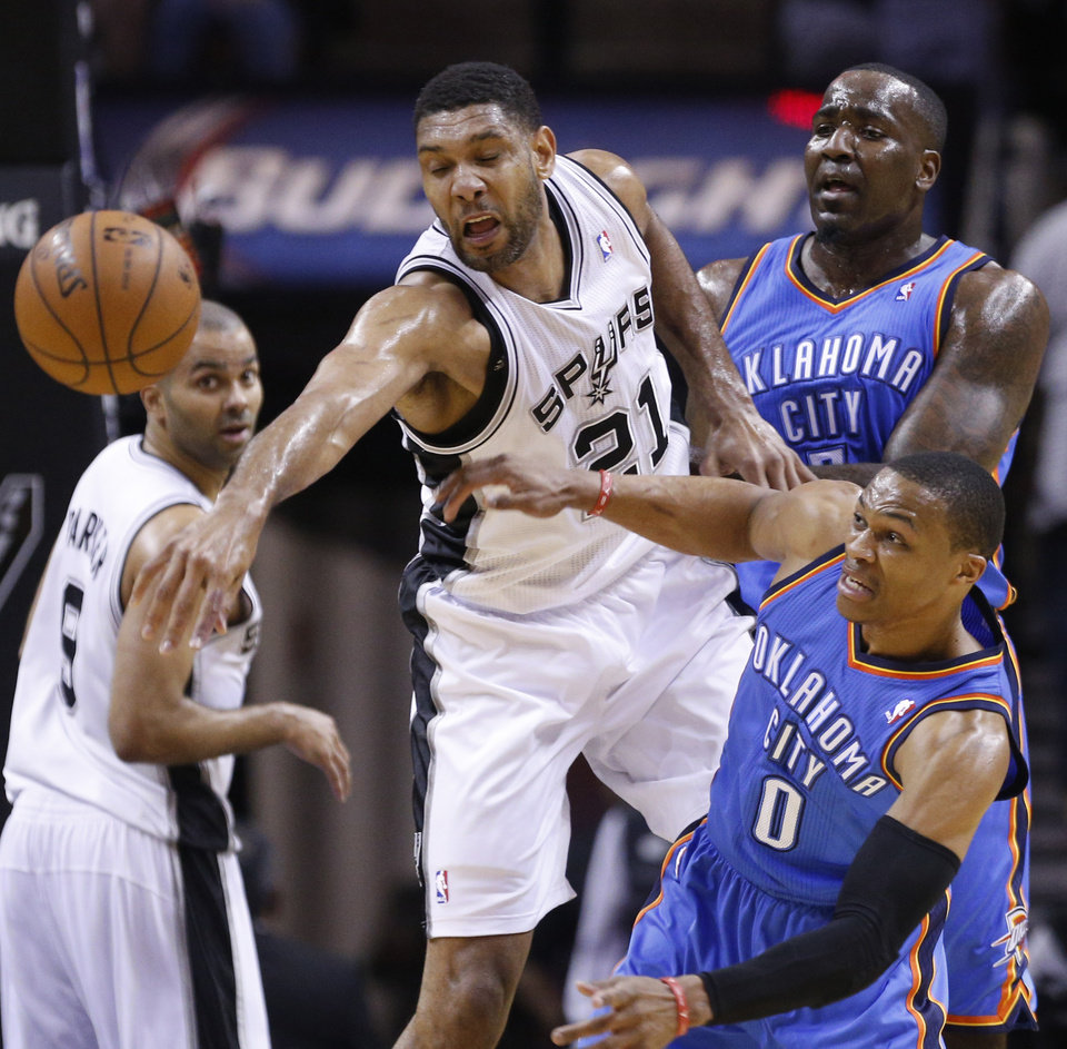 Photo - Oklahoma City's Russell Westbrook (0) is fouled by San Antonio's Tim Duncan (21) during Game 5 of the Western Conference Finals in the NBA playoffs between the Oklahoma City Thunder and the San Antonio Spurs at the AT&T Center in San Antonio, Thursday, May 29, 2014. Photo by Sarah Phipps, The Oklahoman