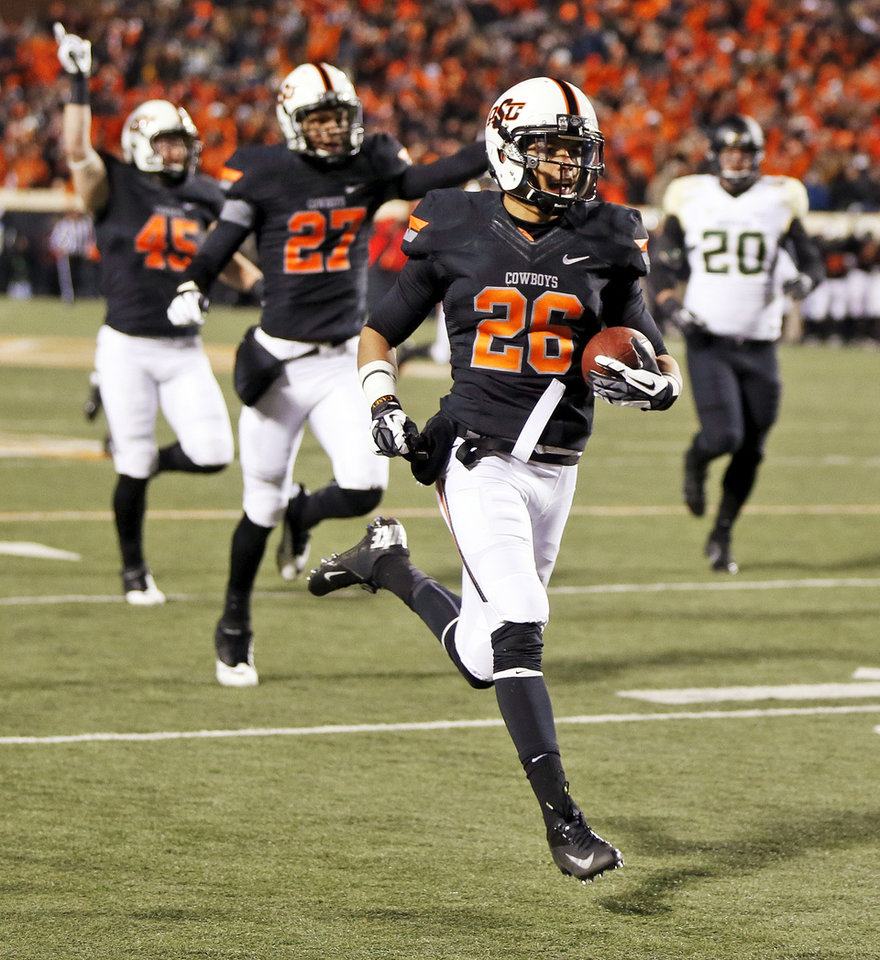 Oklahoma State's Tyler Patmon (26) returns a fumble for a touchdown in front teammates Caleb Lavey (45) and Lyndell Johnson (27) along with Baylor's Jerod Monk (20) in the fourth quarter during a college football game between the Oklahoma State University Cowboys (OSU) and the Baylor University Bears (BU) at Boone Pickens Stadium in Stillwater, Okla., Saturday, Nov. 23, 2013. OSU won, 49-17. Photo by Nate Billings, The Oklahoman