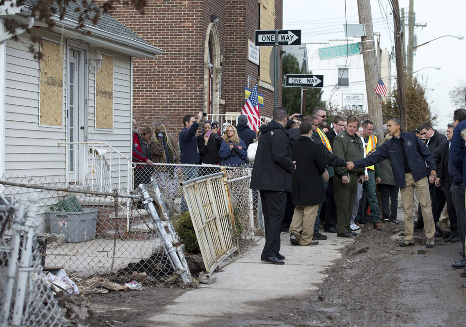 <p>President Barack Obama visits with people on Cedar Grove Avenue, a street significantly impacted by Superstorm Sandy, on the Staten Island borough of New York, Thursday, Nov. 15, 2012. (AP Photo/Carolyn Kaster)</p>