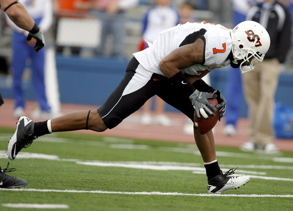 Photo - Oklahoma State's Michael Harrison (7) recovers a blocked punt for a touchdown during the college football game between Oklahoma State (OSU) and Kansas (KU), Saturday, Nov. 20, 2010 at Memorial Stadium in Lawrence, Kan. Photo by Sarah Phipps, The Oklahoman