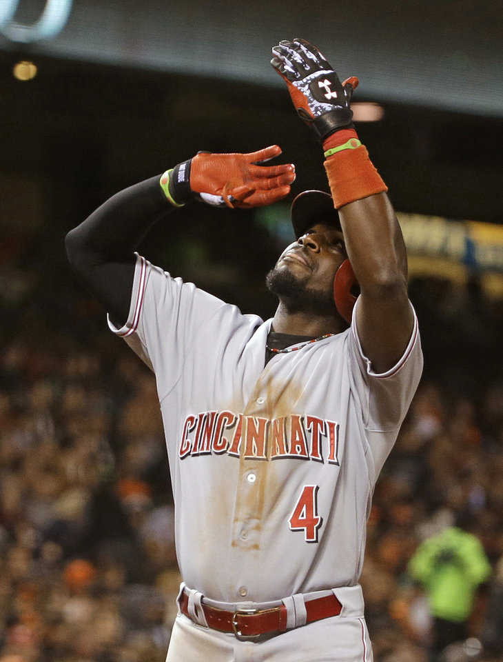 Cincinnati Reds' Brandon Phillips gestures while crossing home plate after hitting a home run off San Francisco Giants relief pitcher Jean Machi in the seventh inning of a baseball game Thursday, June 26, 2014, in San Francisco. (AP Photo/Eric Risberg)