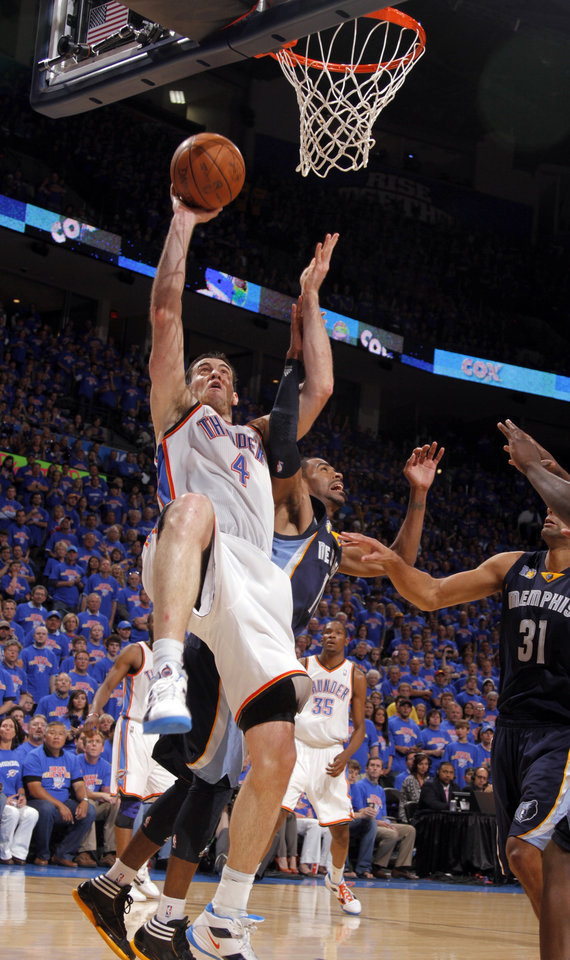 Photo - Oklahoma City's Nick Collison (4) shoots as Mike Conley (11) of Memphis defends during game 7 of the NBA basketball Western Conference semifinals between the Memphis Grizzlies and the Oklahoma City Thunder at the OKC Arena in Oklahoma City, Sunday, May 15, 2011. Photo by Sarah Phipps, The Oklahoman