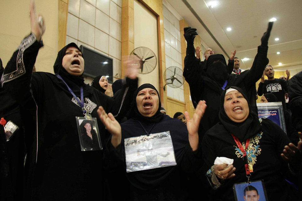 Photo - Families of the victims of the Ultras Al-Ahli, football supporters react in court with joy after the issuance of the death penalty for 21 accused in last years Port Said football violence, in Cairo, Egypt, Saturday, Jan. 26, 2013. Egyptian security officials say a senior police officer and a policeman were shot dead in the Mediterranean city of Port Said after a judge sentenced 21 people to death in connection to one of the world's deadliest incidents of soccer violence. (AP Photo/Ahmed Abd El-Latef, Shorouk Newspaper)   EGYPT OUT