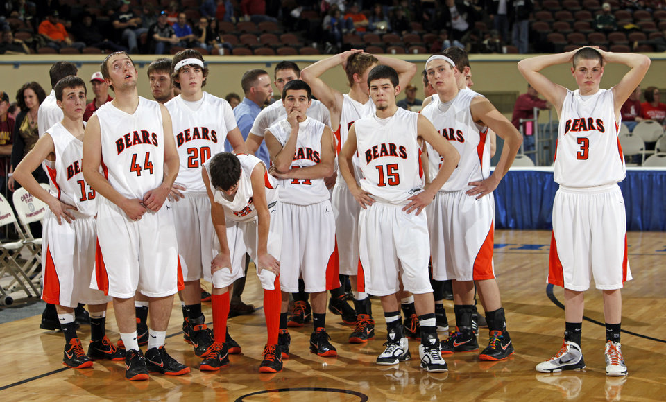 REACTION: The Cheyenne-Reydon Bears stand together after losing the Class A boys high school basketball state tournament championship game between Cheyenne-Reydon and Fort Cobb-Broxton at State Fair Arena in Oklahoma City, Saturday, March 5, 2011. Fort Cobb-Broxton won, 50-41. Photo by Nate Billings, The Oklahoman ORG XMIT: KOD
