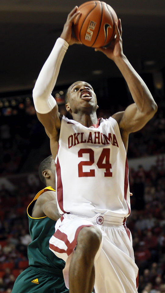 Photo - Oklahoma's Buddy Hield (24) takes the ball to the hoop during an NCAA men's college basketball game between Baylor and the University of Oklahoma (OU) at Lloyd Noble Center in Norman, Okla., Saturday, Feb. 8, 2014. Photo by Nate Billings, The Oklahoman