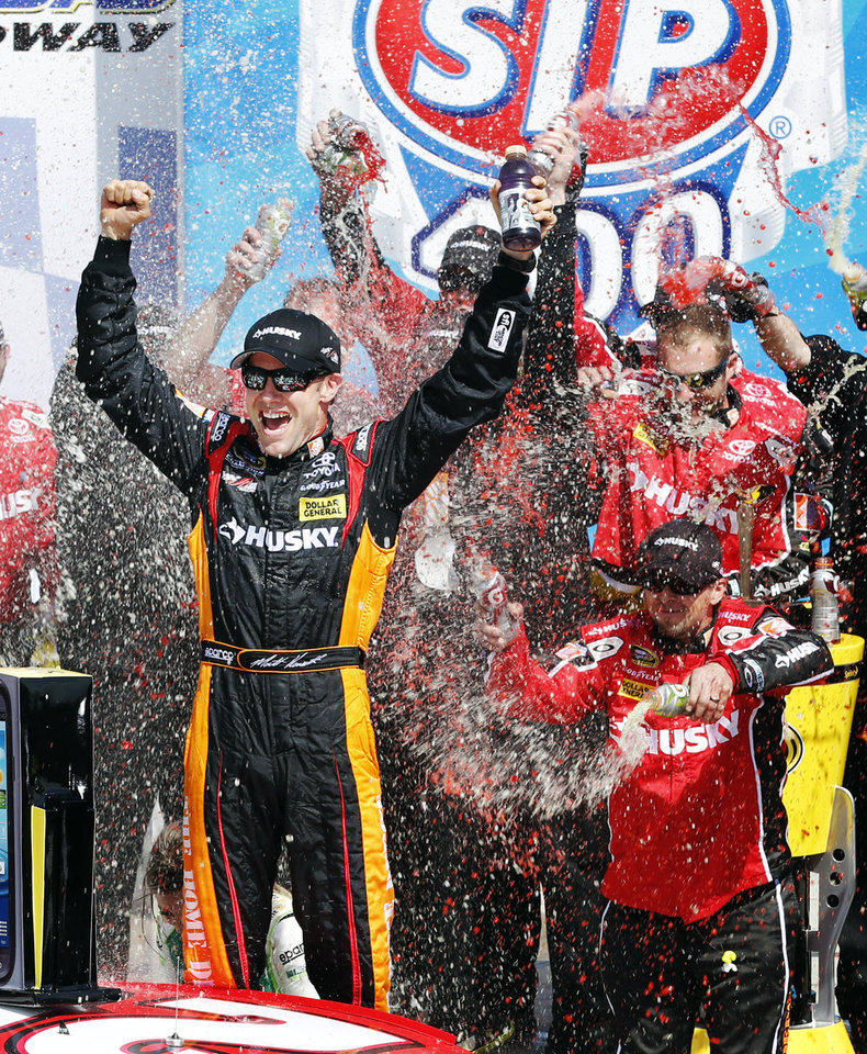Photo - Matt Kenseth (20) celebrates in Victory Lane after winning the NASCAR Sprint Cup Series auto race at Kansas Speedway in Kansas City, Kan., Sunday, April 21, 2013. (AP Photo/Orlin Wagner)