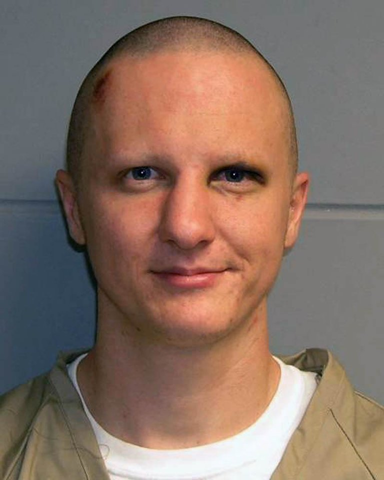 Photo -   FILE - This photo released Tuesday, Feb. 22, 2011, by the U.S. Marshal's Service shows Jared Lee Loughner. Loughner, who pleaded guilty in the Tucson mass shooting that left six people dead and former U.S. Rep. Gabrielle Giffords and 12 others wounded, is scheduled to be sentenced Thursday under a plea agreement that guarantees he will spend the rest of his life in prison. (AP Photo/U.S. Marshal's Office, File)