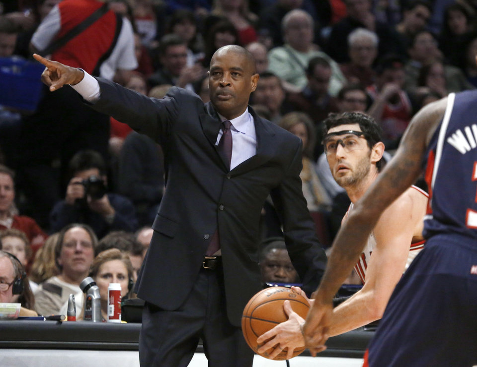 Photo - Atlanta Hawks coach Larry Drew gestures as Chicago Bulls guard Kirk Hinrich advances the ball during the second half of an NBA basketball game Monday, Jan. 14, 2013, in Chicago. The Bulls won 97-58. (AP Photo/Charles Rex Arbogast)