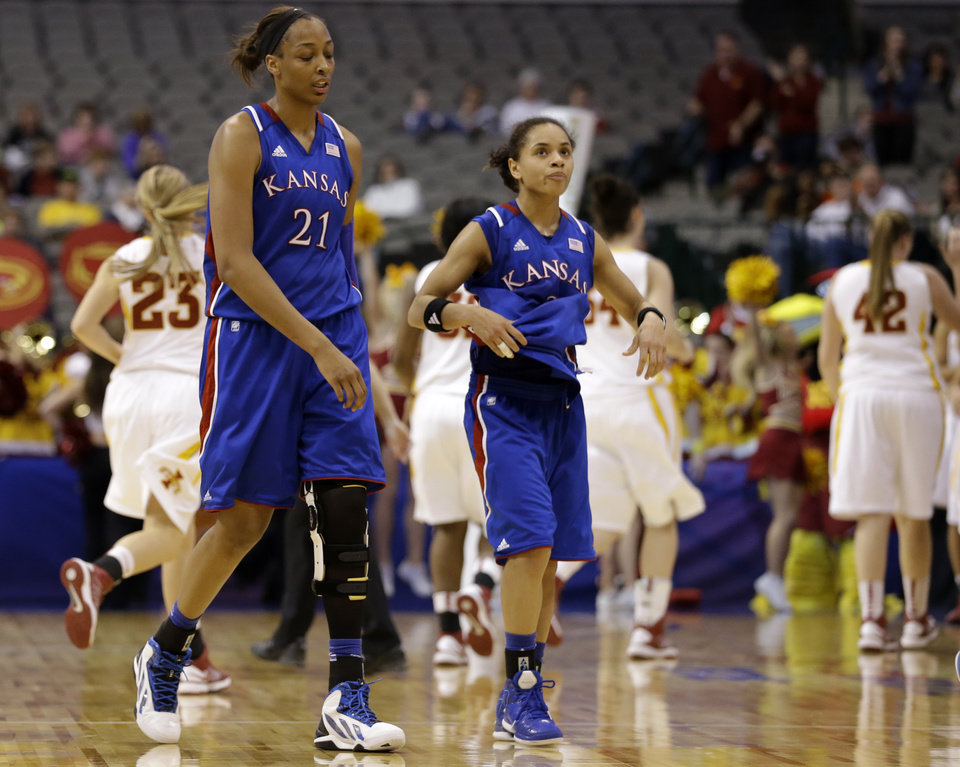 Photo - Kansas' Carolyn Davis (21) and Angel Goodrich (3) walk back to the bench at the end of an NCAA college basketball game against Iowa State in the Big 12 women's tournament on Saturday, March 9, 2013, in Dallas. Iowa State won 77-62. (AP Photo/Tony Gutierrez)