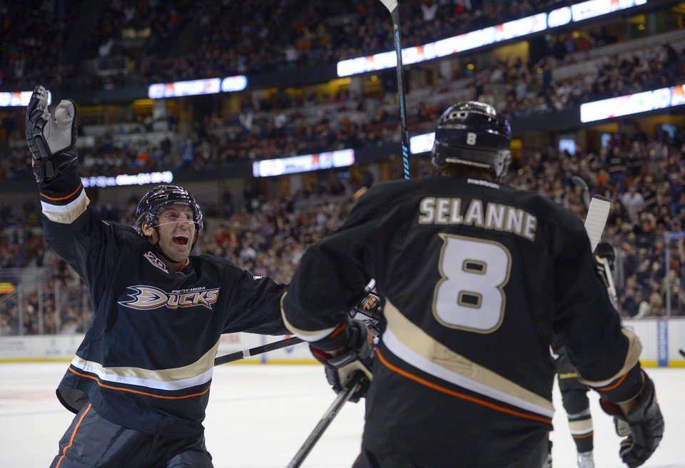 Anaheim Ducks defenseman Francois Beauchemin, left, congratulates right wing Teemu Selanne, of Finland, after Selanne scored during the second period of an NHL hockey game against the Edmonton Oilers, Sunday, Dec. 15, 2013, in Anaheim, Calif. (AP Photo/Mark J. Terrill)