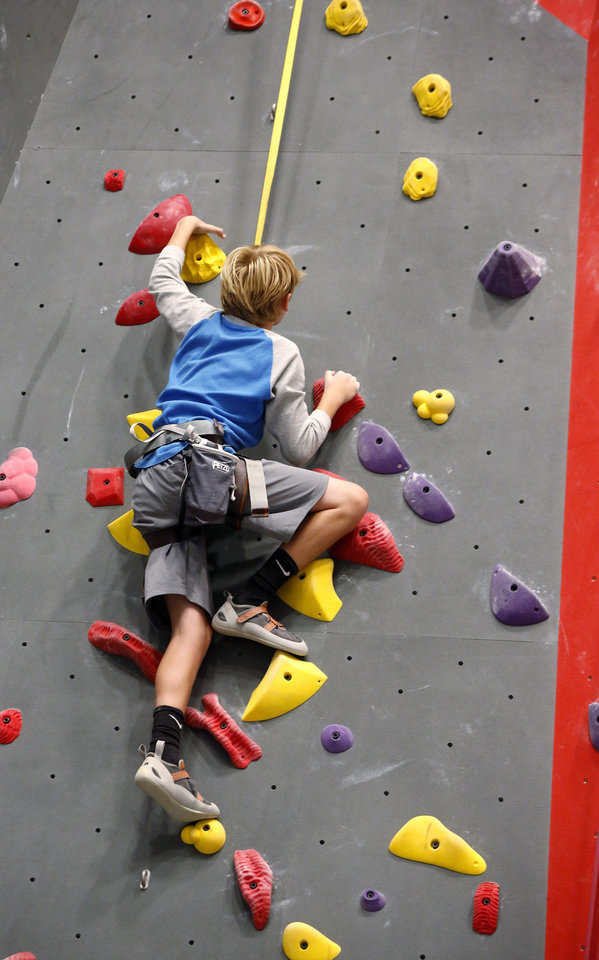 Photo - A boy makes his way up one of the climbing walls inside Threshold Climbing, located at  6024 Westlake Memorial Pkwy, on Tuesday, July 25, 2017.  Photo by Jim Beckel, The Oklahoman