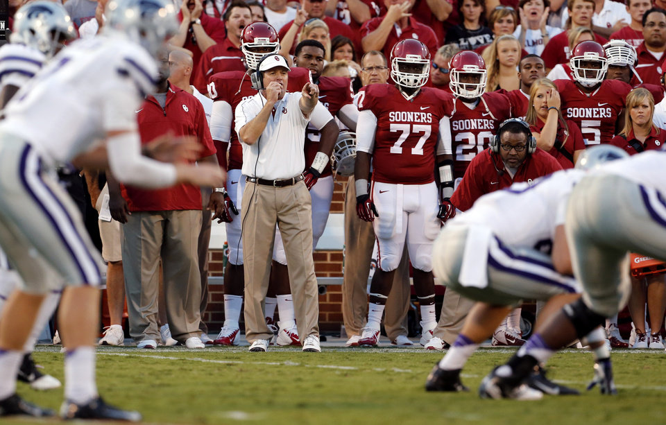 Photo - Head coach Bob Stoops talks on his head set during a college football game between the University of Oklahoma Sooners (OU) and the Kansas State University Wildcats (KSU) at Gaylord Family-Oklahoma Memorial Stadium, Saturday, September 22, 2012. Photo by Steve Sisney, The Oklahoman