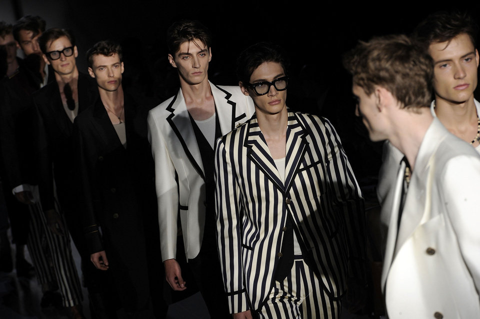 Photo - Models wear creations for Gucci men's Spring-Summer 2015 collection, part of the Milan Fashion Week, unveiled in Milan, Italy, Monday, June 23, 2014. (AP Photo/Giuseppe Aresu)