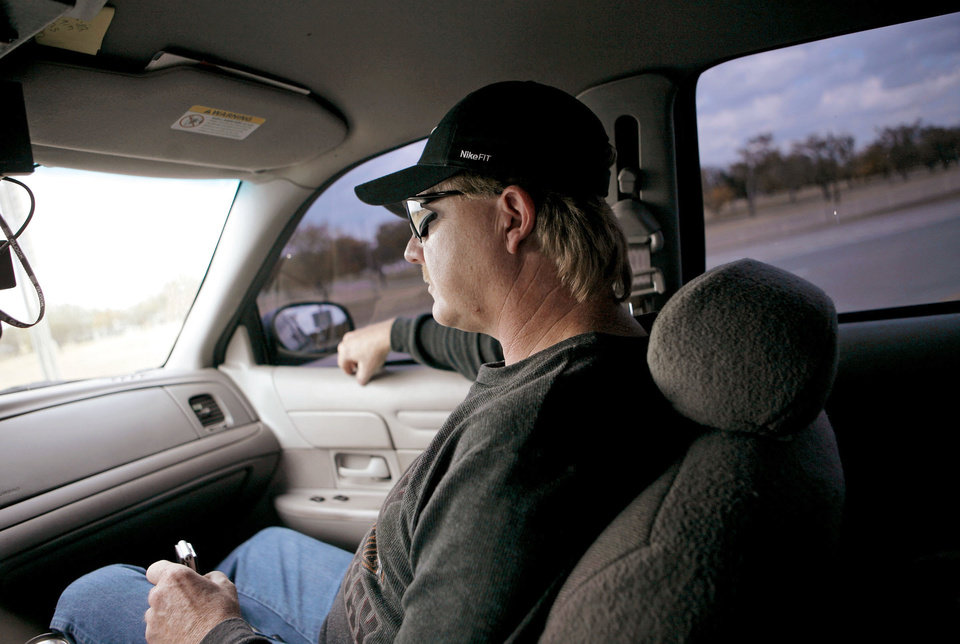 Lt. Darrell Southerland of Lawton's Gang Task Force drives past Fort Sill.  Photo By John Clanton, The Oklahoman.