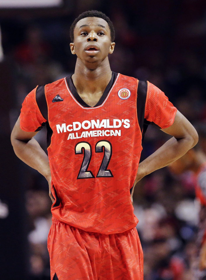 Photo - FILE - In this April 3, 2013, file photo, Andrew Wiggins looks up during the first half of the McDonald's All-American boys basketball game in Chicago. Wiggins signed a letter-of-intent with the University of Kansas at a private ceremony, Tuesday, May 14,  2013, in Huntington, W.Va. The Canadian star averaged 23.4 points and 11.2 rebounds per game this season for West Virginia's Huntington Prep. (AP Photo/Nam Y. Huh, File)