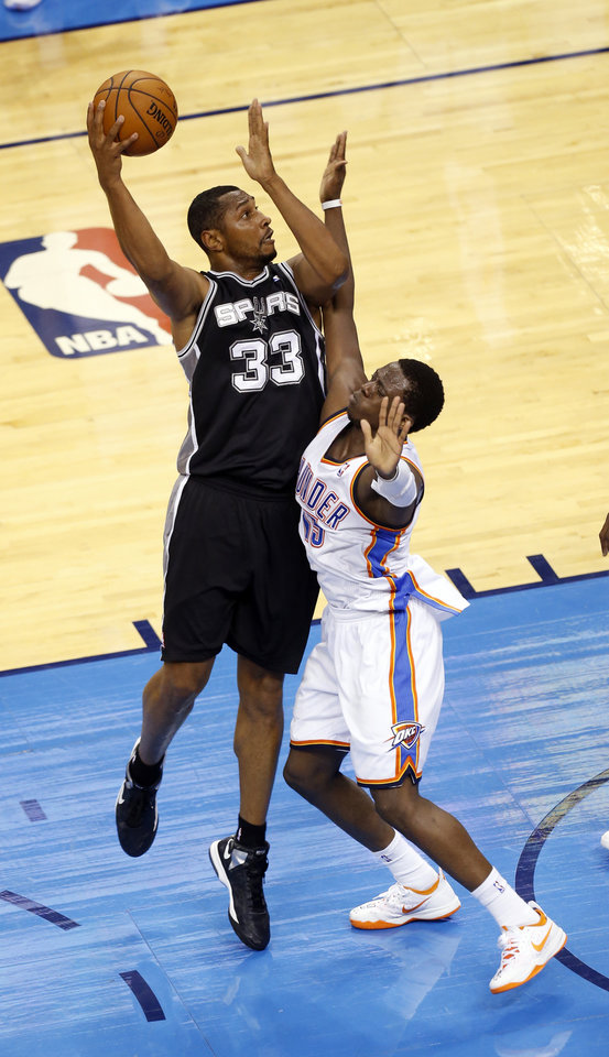 Photo - San Antonio's Boris Diaw (33) shoots as Oklahoma City's Reggie Jackson (15) defends during Game 3 of the Western Conference Finals in the NBA playoffs between the Oklahoma City Thunder and the San Antonio Spurs at Chesapeake Energy Arena in Oklahoma City, Sunday, May 25, 2014. Photo by Nate Billings, The Oklahoman