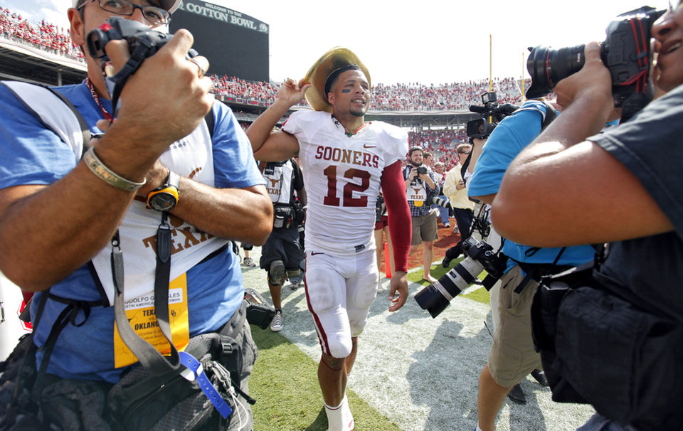Photo - Travis Lewis wears the Golden Hat trophy after the Sooners defeated Texas 55-17 during the Red River Rivalry college football game between the University of Oklahoma Sooners (OU) and the University of Texas Longhorns (UT) at the Cotton Bowl in Dallas, Saturday, Oct. 8, 2011. Photo by Chris Landsberger, The Oklahoman