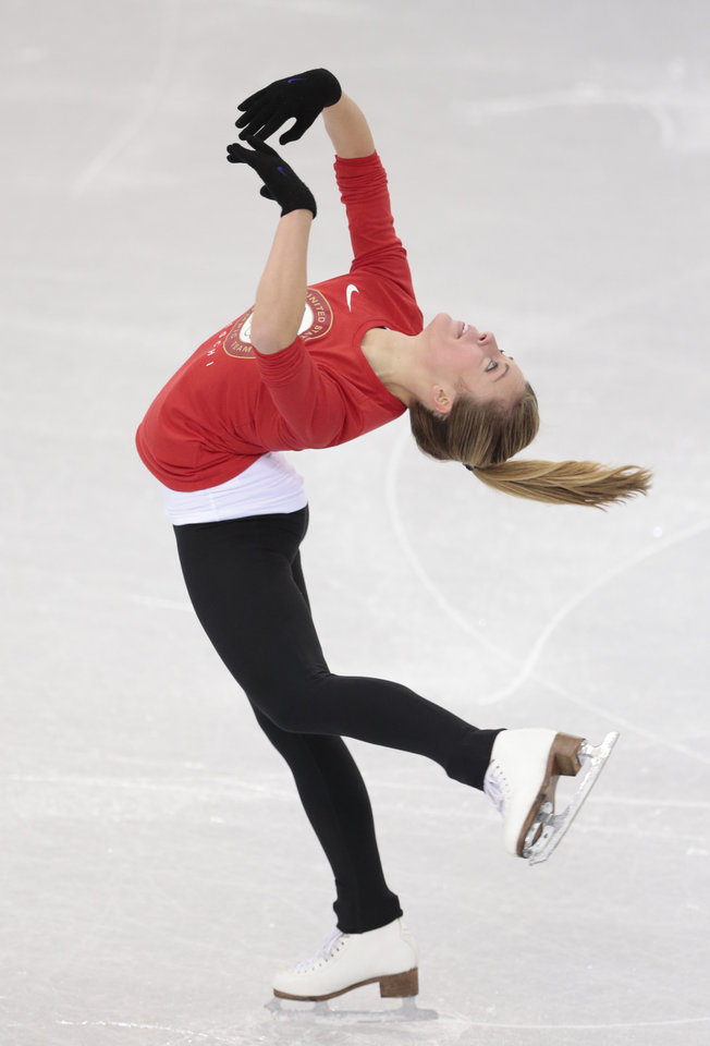 Photo - Ashley Wagner, of the United States, skates at the figure stating practice rink ahead of the 2014 Winter Olympics, Wednesday, Feb. 5, 2014, in Sochi, Russia. (AP Photo/Ivan Sekretarev)