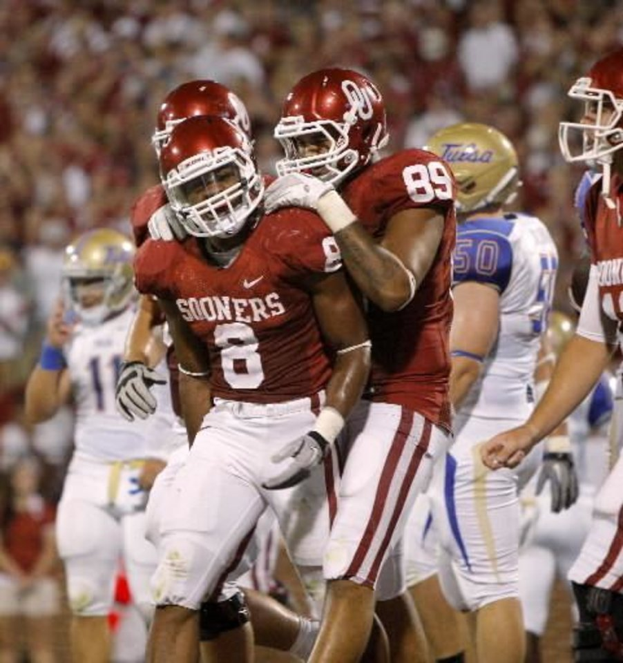 Photo - Oklahoma's Dominique Whaley (8) and Austin Haywood (89) celebrate after Whaley scored a touchdown during the college football game between the University of Oklahoma Sooners ( OU) and the Tulsa University Hurricanes (TU) at the Gaylord Family-Memorial Stadium on Saturday, Sept. 3, 2011, in Norman, Okla. Photo by Bryan Terry, The Oklahoman ORG XMIT: KOD