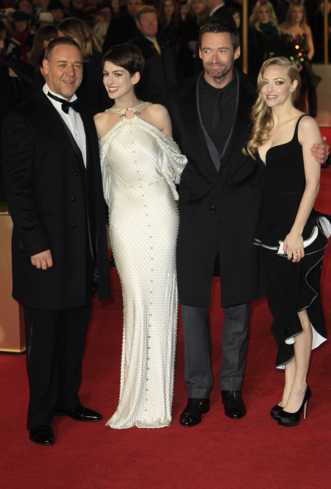 Photo - Russell Crowe, Anne Hathaway, Hugh Jackman and Amanda Seyfried arrive on the red carpet for the World Premiere of 'Les Miserables' at a central London cinema in Leicester Square, Wednesday, Dec. 5, 2012. (Photo by Joel Ryan/Invision/AP)