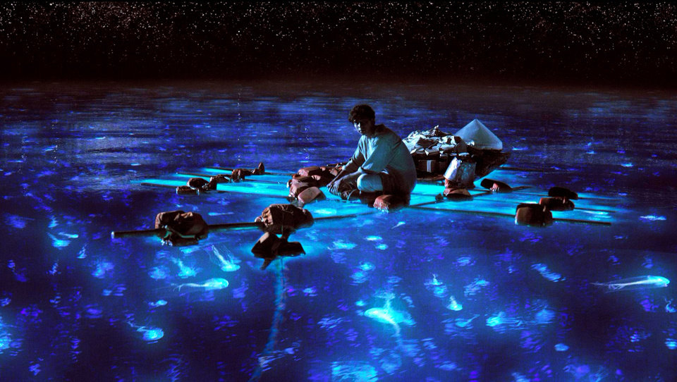 "This publicity photo released by 20th Century Fox shows Suraj Sharma as Pi Patel taking in the bioluminescent wonders of the sea in a scene from the film, ""Life of Pi."" With 11 Academy Awards nominations, second only to �Lincoln� with 12, and the sort of global box-office receipts normally reserved for superheroes, �Life of Pi� is one of the most unusual megahits ever to hit the big-screen.  (AP Photo/20th Century Fox)"
