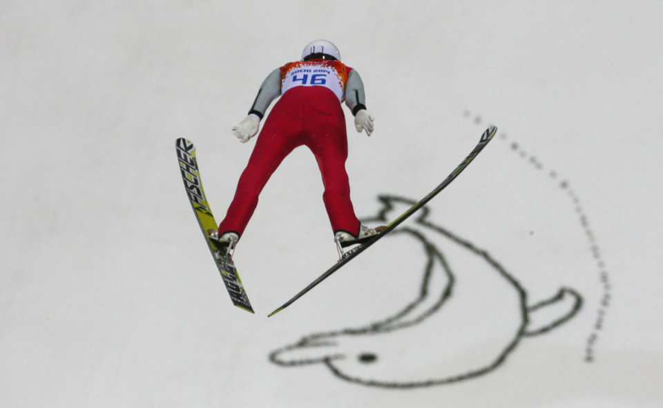 Photo - Germany's Eric Frenzel makes his trial jump during the Nordic combined individual Gundersen large hill competition at the 2014 Winter Olympics, Tuesday, Feb. 18, 2014, in Krasnaya Polyana, Russia. (AP Photo/Dmitry Lovetsky)