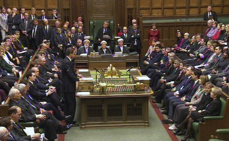 Photo - Britain's Prime Minister David Cameron, standing centre left, as he gives a tribute to Baroness Margaret Thatcher inside the House of Commons, in London, Wednesday April 10, 2013.   The British Parliament was convened for a special session Wednesday to pay tribute to former Prime Minister Margaret Thatcher, the