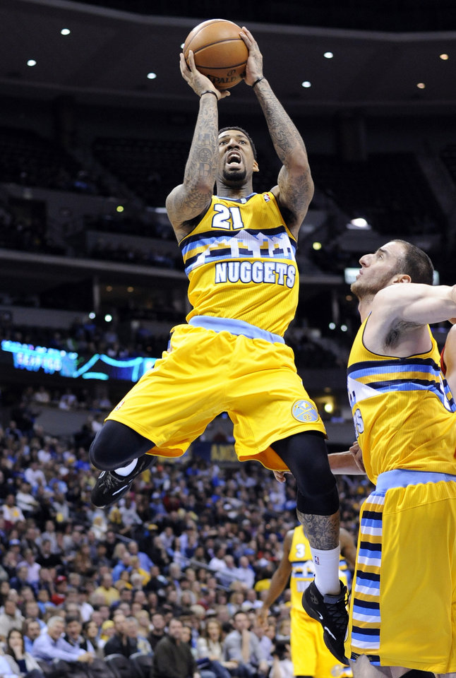 Denver Nuggets guard Wilson Chandler shoots against the Portland Trail Blazers during the third quarter of an NBA basketball game, Tuesday, Jan. 15, 2013, in Denver. (AP Photo/Jack Dempsey)