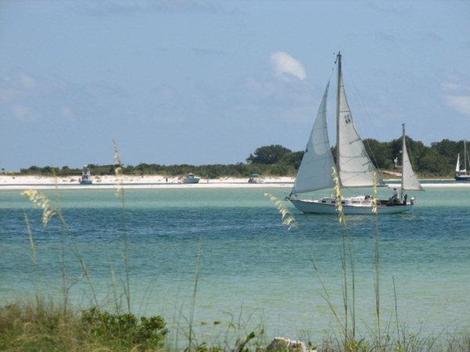 Photo - A sailboat goes searching for a Gulf breeze in Perdido Key, Fla.